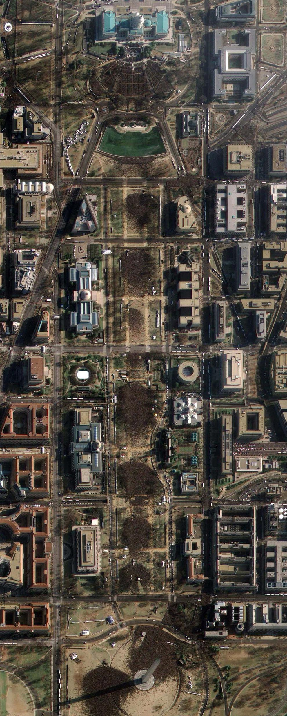 This image provided by GeoEye Satellite Image shows Washington D.C.'s National Mall and the United States Capitol (top), in Washington D.C. on Tuesday, Jan. 20, 2009 taken at 11:19AM EDT during the inauguration of President Barack Obama. The image, taken through high, wispy white clouds, shows the masses of people between the Capitol and the Washington Monument.