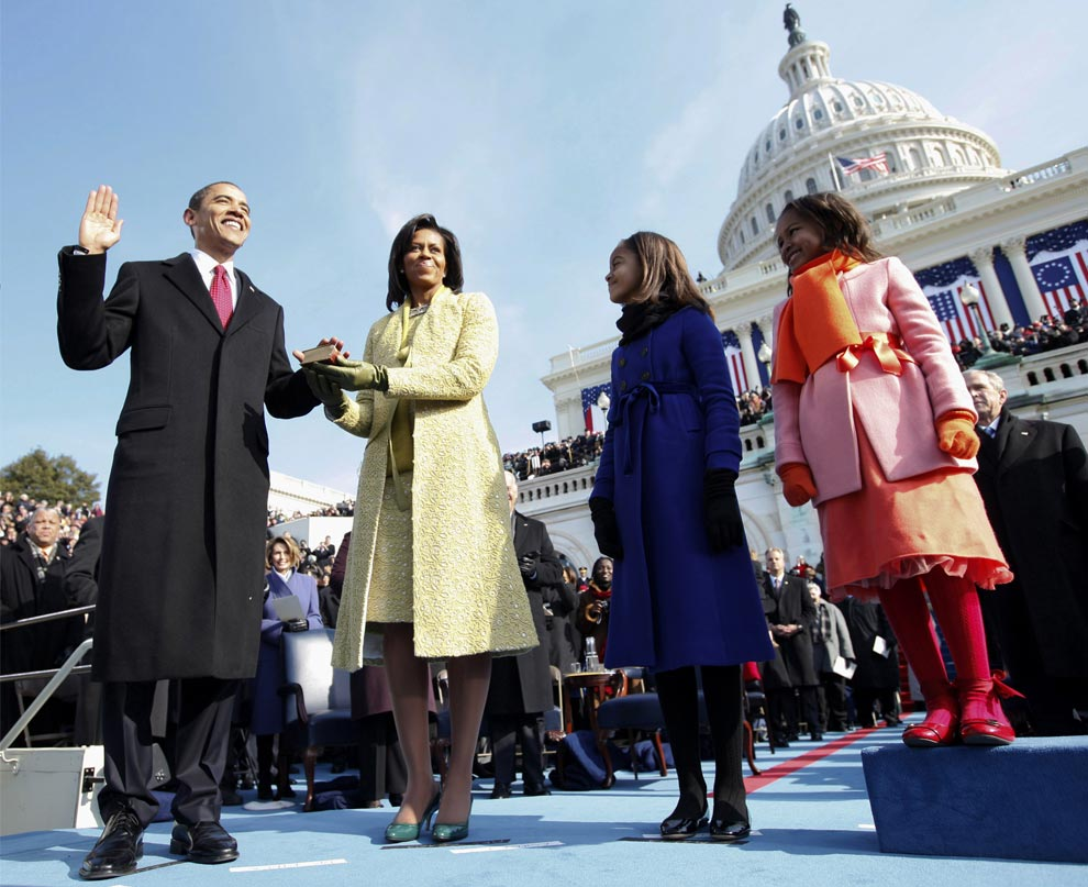 Barack H. Obama is sworn in as the 44th president of the United States as his wife Michelle Obama holds the Bible and their daughters Malia Obama and Sasha Obama look on, on the West Front of the Capitol January 20, 2009 in Washington, DC.