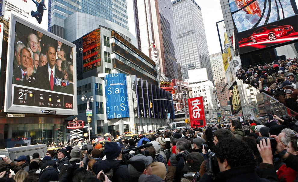 Spectators in Times Square watch President Barack Obama take the oath of office during his inauguration Tuesday, Jan. 20, 2009 in New York.