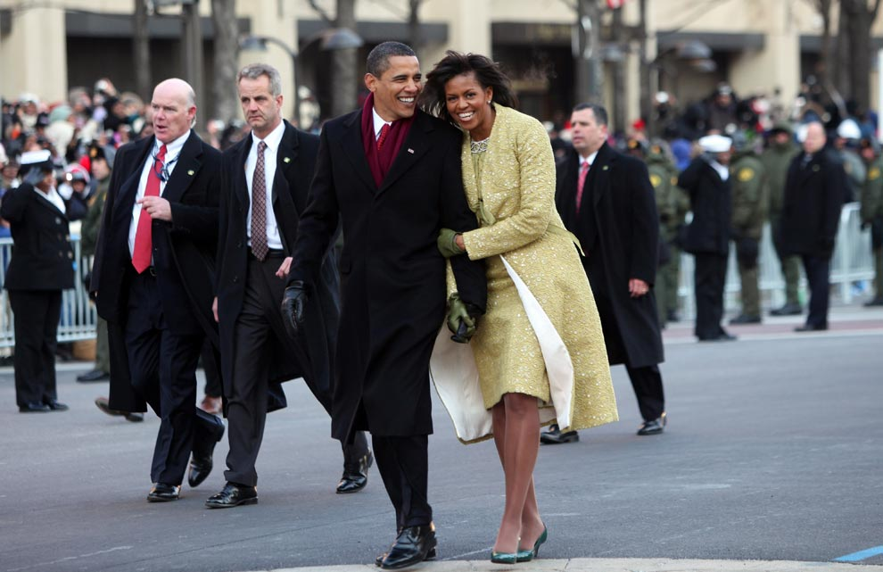 U.S. President Barack Obama and first lady Michelle Obama walk in the inaugural parade following his inauguration as the 44th President of the United States of America on January 20, 2009 in Washington, D.C.